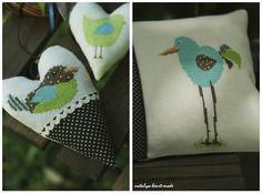 heartmade cross stitch birds on a pillow and a heart
