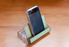 An easy Smart phone stand using an old cassette case. good idea