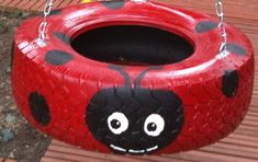 Lady Bug Tire swing! Could also do it green and make a frog or turtle.  Clean the surface of the tire first then paint with non toxic primer and paint
