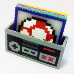 Nintendo-themed coasters in a controller box made from those iron-together beads. This is a really fun idea, and easy too.these would be great as plastic canvas