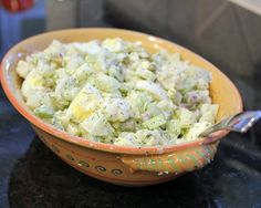 No Potato Cauliflower Salad with chopped boiled eggs, pickle, celery...basically a normal potato salad but with steamed cauliflower instead! Interesting take...interesting enough to try!