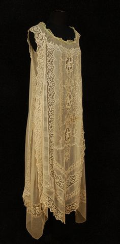 Peignoir set, circa 1910. Both sleeveless sheer cream cotton with filet lace and embroidered with dragonflies and flowers, the gown of four panels with pointed hem, the front having three medallions of figural needle lace, net side panels, green chiffon neck band.