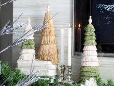For this mantel design, sheen is added through a trio of floral cones covered in greige, olive-green and gold fringe trim, while metallics are present in the form of pewter candlesticks. Find these accessories or similar items in most department or home stores, and earn cash back on décor purchases with Chase Freedom.  #HolidayHouse