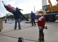 For the first time, Dallas' iconic Big Tex wears a mask during State Fair season