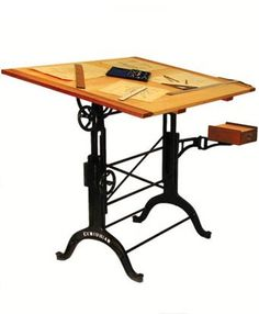 WANT! Old-style drafting table.