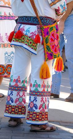 Colorful embroidery adorns the clothing of Huichol artisans attending the 2010 Folk Art Market in Santa Fe, New Mexico
