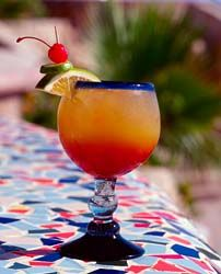 The famous rum punch ~ You wont be disappointed with this Jamaican rum drink.    Ingredients  1 cup Orange Juice  1 cup Pineapple Juice  1 cup Apple Juice  3 Ripe Bananas puréed in a blender  2 ½ cups water  ½ cup Appleton white rum    Preparation  Add all ingredients to a bowl.  Mix slowly to ensure mixing then vigorously.  Remove 1 cup and then place in blender  Liquefy mixture then add ice cubes if desired. #jamaica #travel