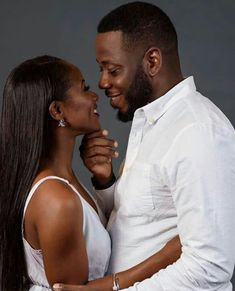 Black Couple looking into each others eyes. #BlackLove