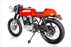 """Yamaha SR250. I really like the checkered seat and the weird orange/red color. I also feel like this one leans more toward the """"short and stocky"""" even though it doesn't have an air box."""