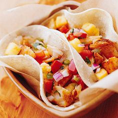 Grilled Fish Tacos  Using flavor-packed grilled fish helps keep the fat and calories low for this fun dinner.