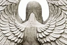 Angel's Wings: sand sculpture from Revere Beach, processed to make the sand look like aged stone. Photo by Eric Kilby/Flickr.
