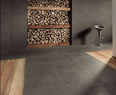 Great, large tiles that flow from the wall to floor.  Recessed wood storage is a growing trend.
