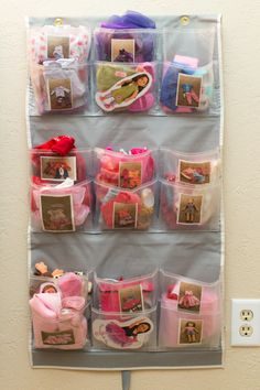 Store American Girl doll clothes - cut an over-the-door shoe organizer in half so little ones can reach the highest pockets and hang on the wall. Clear pockets make it easy to see inside and each pocket has a picture of what should be inside taped to the front.