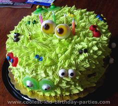 "Monster Cake ~ lime green frosting and a decorating tip cover a round cake in ""hair"". Then make a variety of ""eyes"" out of different kinds of candy. With two big gummy eyeballs right on top"