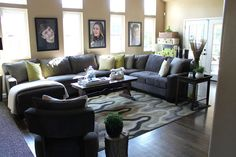 Family Friendly Living Room...classy, yet comfortable. Love the pictures of the kids on the wall!