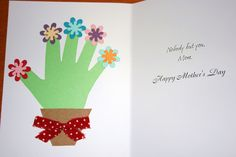 Handprint flower pots to make with your kids for Mother's Day or birthday cards.  I used some precut paper flowers, construction paper for the handprint, brown paper bag cut into flower pots and glued a bow on top.