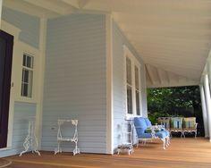Victorian wrap around porch, vintage porch furniture, blue house, white trim, black shutters, red door, refinished deck, olloclip