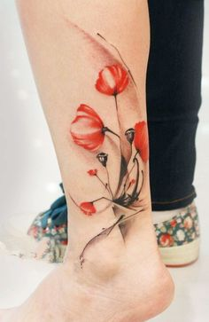 flower tattoo - the coloring is spectacular and i like the simplicity of the design