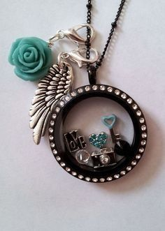 Beautiful #black #teal #locket from #origamiowl #adorable #jewelry Purchase from AshleyDearstine.origamiowl.com Join my team, designer ID#49201