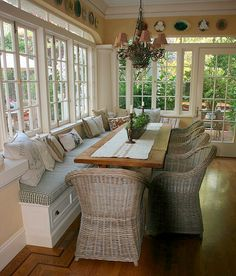 screened in porch with built-in-bench seating. could use with a table like this for dining, or no table and just to relax and sit on with an open room