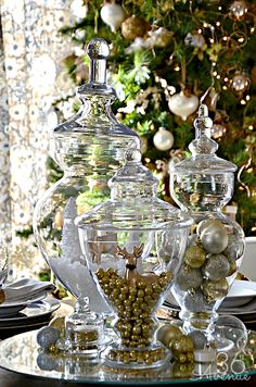 glass vases and ornaments create a lovely centerpiece...