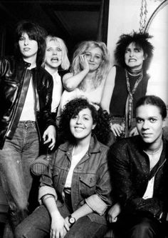 An amazing amount of cool in one photo.    From the left: Chrissie Hynde (The Pretenders), Deborah Harry (Blondie), Viv Albertine (The Slits), Siouxsie Sioux (Siouxsie & the Banshees), front: Poly Styrene (X-Ray Spex), Pauline Black (The Selector)  .  Photo by Michael Putland for the New Musical News in 1980.