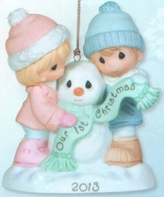 Precious Moments Our First Christmas Together 2013 Dated Ornament From the Annual Precious Moments Dated Christmas Collection. We invite you to Commemorate your First Christmas Together with this 2013 Dated Christmas Ornament. This year's annual first Christmas ornament features a couple building a snowman together. This ornament is made of porcelain. #PreciousMoments #Christmas