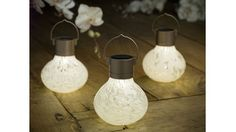 {solar powered glass lanterns} I'd hang these above my sitting nook. so pretty!