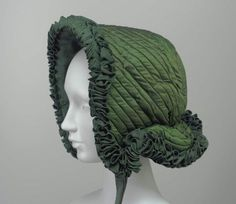 Winter bonnet, mid nineteenth century, Silk twill, figured silk lining and trim, canes, and wool batting, Museum of Fine Arts, Boston