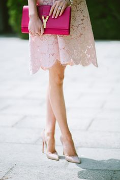 hot pink envelope clutch with nude coloured lace dress and nude shoes - I would most probably wear hot pink heels with this but that's just my opinion