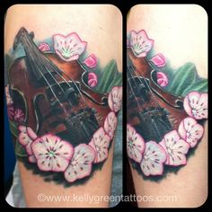 Another pinner said: Violin and mountain laurel tattoo done on the one and only Katrina