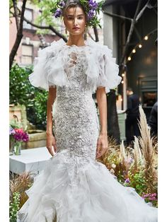 Fit and flare wedding dress with beading and sleeves | Pin discovered by Kelly's Closet bridal boutique in Atlanta, Georgia