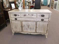 SOLD - This shabby chic mahogany buffet is painted a crisp linen, antiqued, & heavily distressed - finished with clear wax. It has 2 long drawers and a 3 door cabinet for storage. This piece could be used as a media center as well!  ***** In Booth F9 at Main Street Antique Mall 7260 E Main St (east of Power RD on MAIN STREET) Mesa Az 85207 **** Open 7 days a week 10:00AM-5:30PM **** Call for more information 480 924 1122 **** We Accept cash, debit, VISA, MasterCard or Discover.