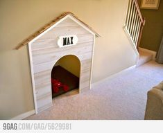 Built-in dog house under the stairs.
