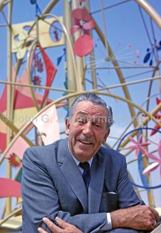 "Walt Disney in front of the Tower of the Four Winds, ""It's a Small World"" Exhibit, 1964 World's Fair, Flushing Meadows, New York."