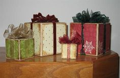 Presents made from blocks of wood and scrapbook paper. All you would need to do is Modge Podge scrapbook paper cut to size (edges inked if you you like that look) and tie some ribbon or tulle into a bow on top. Simple decoration for your home or to give to someone as a gift.