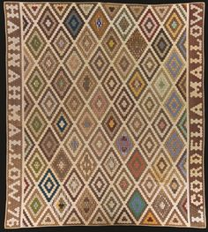 """""""Diamond Field"""" quilt, circa 1890-1910, made by L. Cordelia and Hannah Mallow.  Interesting border."""