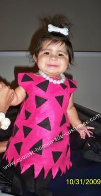 Homemade Pebbles Flinstone Costume: I made my 9 month old daughter a Homemade Pebbles Flinstone Costume. She was Pebbles from the Flintstones. I used bright pink and black felt. I doubled