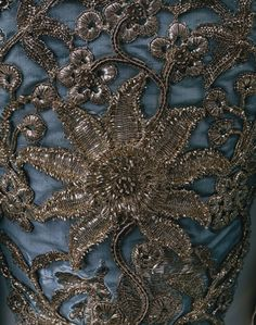 Detail of silver thread embroidery on a Court dress. (Click on the image to see the dress)