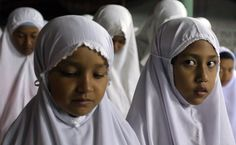 Thai Muslim children pray at a mosque during Ramadan in Narathiwat province in Thailand on September 9, 2008. (MADAREE TOHLALA/AFP/Getty Images)