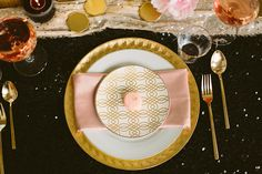 Black and gold place setting with blush accents