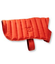 """When the weather outside gets """"ruff"""", our insulated jacket is the perfect layer to keep your pet warm. Quilted polyester shell is weather-resistant, made from the same fabric we use in our camp bags. Adjustable hook and loop closure at the waist and adjustable chest straps provide the best fit. Leash connection slot and tab collar. Machine washable. Imported.</P> <P><B>Small</b>9½""""L. neck to tail; 16""""-21"""" girth.</P> <P><B>Medium</b>15½""""L. neck to tail;, ..."""