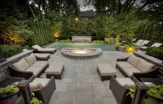This classic backyard takes on a whole new feeling after dark thanks to a carefully arranged complement of LED and halogen garden lights. The extensive mature plantings, which add to privacy, provide a natural canvas for the lighting and help to soften the straight lines of the stonescapes. As darkness falls a set of lights bring the dramatic sheer descent waterfall to life.