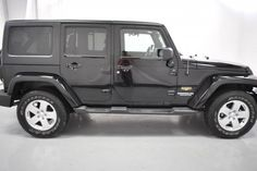 2012 Black Jeep Wrangler Unlimited Sahara http://www.iseecars.com/used-cars/used-jeep-wrangler-for-sale