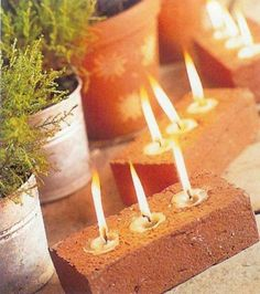 tea lights in the holes of bricks--great idea!  Facebook source