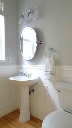 White and grey bathroom. Faux wainscoting. Benjamin Moore Moonshine on the walls.