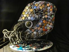 nautilus sculpture made of bottle caps.