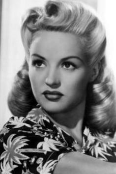 50s hair.  If I could figure out how to do this in the front with my super long hair I'd be a happy camper.