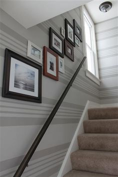 I like the arrangement of these frames. Might work in hallway leading upstairs... stripes wall paint, frame, horizontal wall stripes, pattern, nurseri paint, horizontal stripes, painted stripes on wall, hallway, horizontal striped walls