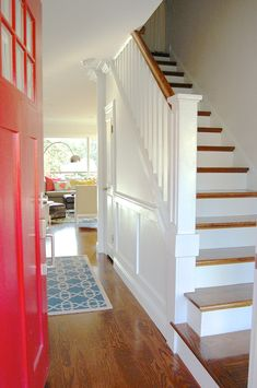 Bright white entry with colorful door | Design Mom